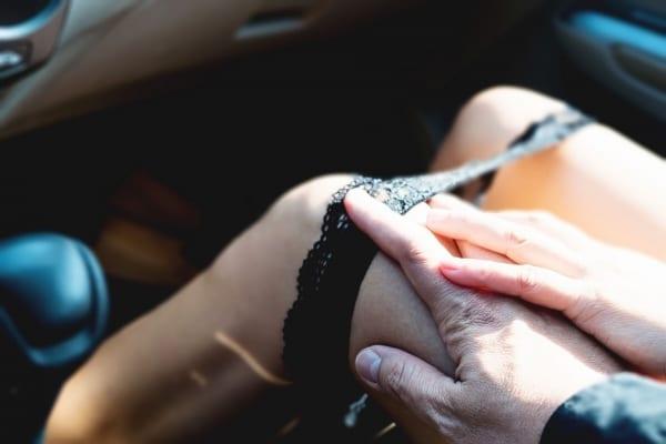Man seducing a woman in a car before sex